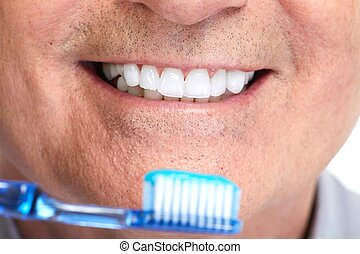 Teeth with toothbrush.