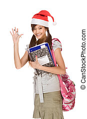 Asian student in Christmas hat gesturing greets - Asian...