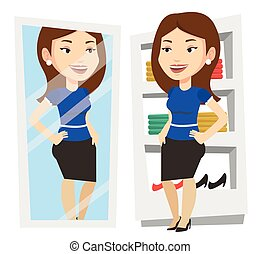 Woman trying on clothes in dressing room. - Young woman...