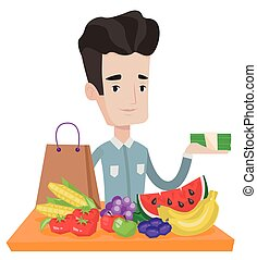 Young man standing at the table with shopping bag -...
