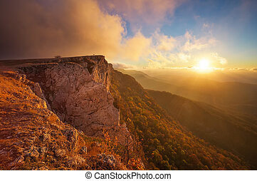Beautiful mountain landscape with sunset sky in autumn time