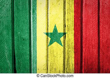 Senegal Flag painted on old wood background