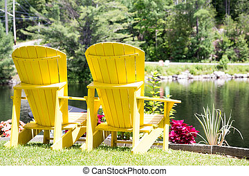 Yellow Muskoka chairs with a view
