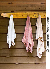 water ski towel rack at the cottage - swimming towels hang...