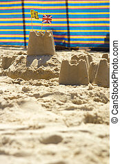 Sandcastles and windbreak - Typical scene on beach with room...