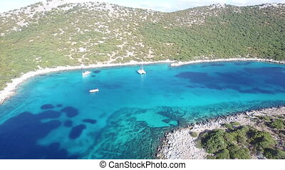 Sailboats In Clear Blue Sea - Aerial view of a beautiful bay...