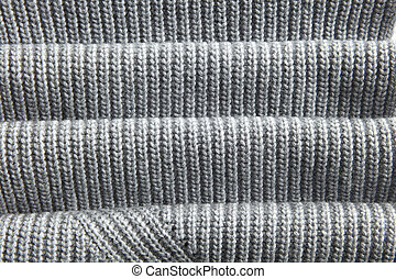 natural warm knitted gray fabric with fabric folds