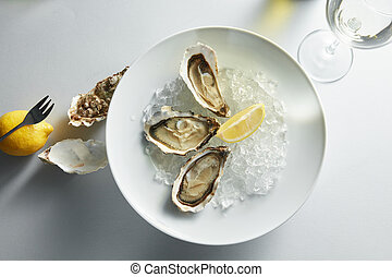 Oysters with lemon on plates