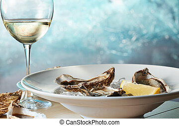 Fresh raw oysters on ice with lemon