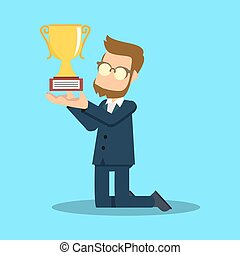 businessman crouching with trophy
