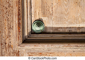 knocker in a door curch lombardy italy varese lonate pozzolo...