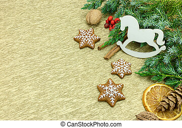homemade gingerbread cookies and christmas decorations on...