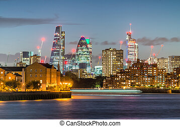 London City modern skyline at night as seen from Canary...
