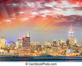 Manhattan skyscapers, New York City at sunset.