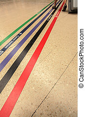 Direction lines on train station - Colourful lines directing...