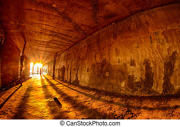 Passage under residential building on the bank of the river...