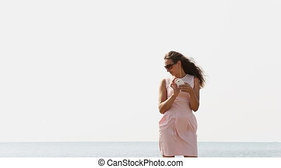 woman photographing on phone