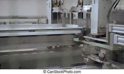 Line production of plastic windows. 4k - Line production of...