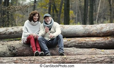 Senior couple on a walk in colorful autumn nature
