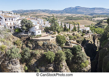 View from the new Bridge over Guadalevin River in Ronda, Malaga, Spain. Popular landmark in the evening