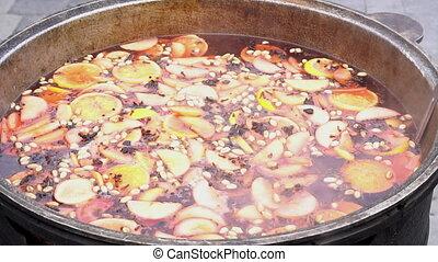 Mulled wine in saucepan. Hot drink. Fruit drink. Food fair....