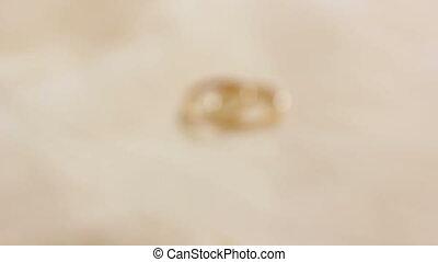 Wedding golden rings, yellow metal, rack focus