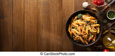 ready pasta on wooden background