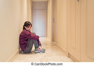 Depressed Woman Sitting on the Floor Alone