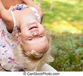 Upside down - Portrait of cute little girl enjoying a summer...