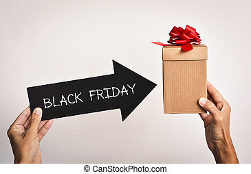 man with a gift box and the text black friday - closeup of a...