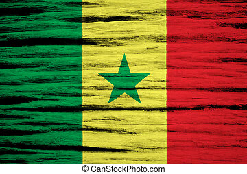 Senegal Flag painted on old wood background