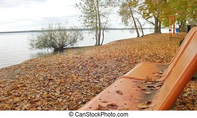 Autumn park The leaves fall on the bench side of the great...