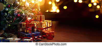 Christmas tree and holidays present on fireplace background...