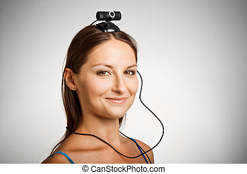 Funny girl with webcamera - Pretty smiling girl with...