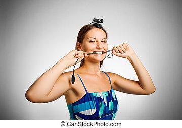 Critical error - Pretty girl biting wire over white...