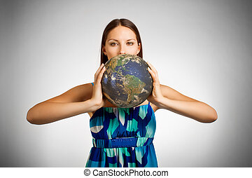 World in hands - Pretty girl holding globe over white