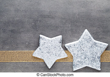 Christmas stars. Christmas pattern. Background on the gray...