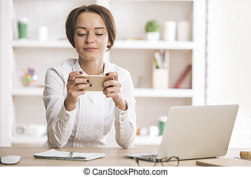 Woman using mobile phone - Portrait of smiling young woman...