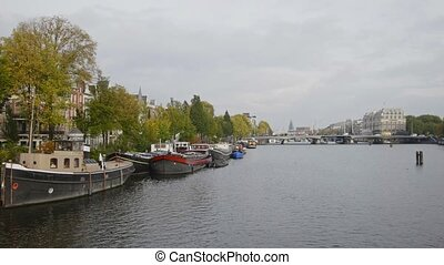 House boat on canal in Amsterdam, Amstel, Holland,...