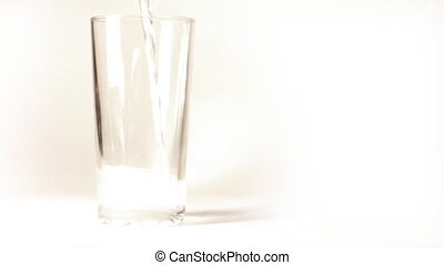 mineral water poured into glass - mineral water is poured...