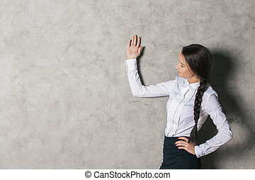 Attractive lady on concrete background - Portrait of...