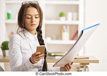 Woman with project using smartphone - Portrait of attractive...