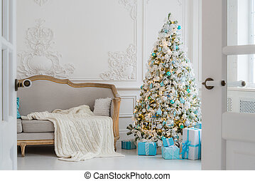 Stylish Christmas interior with an elegant sofa. Comfort...