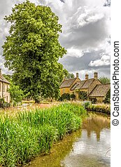 Lower Slaughter in the Cotswolds - Scenic view of Lower...