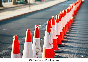 Orange traffic cones - Road work. Orange traffic cones in...