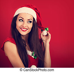 Thinking happy woman in santa claus christmas costume...