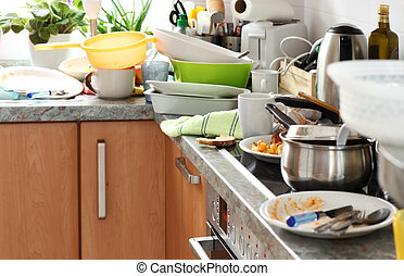 Messy kitchen - Pile of dirty dishes in the kitchen -...