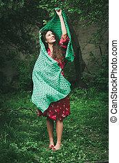beautiful playfull young woman in garden - beautiful smiling...