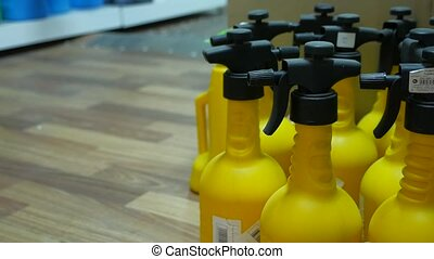 many sprayers in hardware store standing on the floor - many...