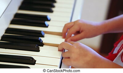 Playing piano child - Baby girl is playing on piano